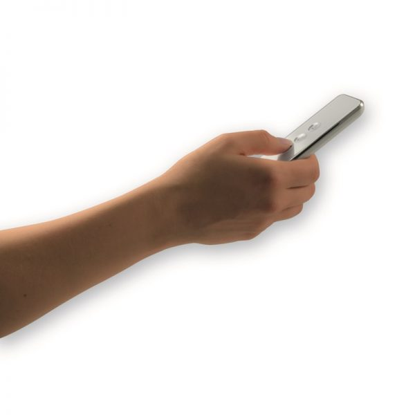 A person holding a silver remote control
