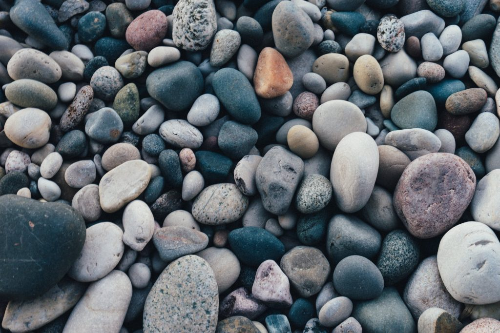 Colourful grey pebbles in the beach