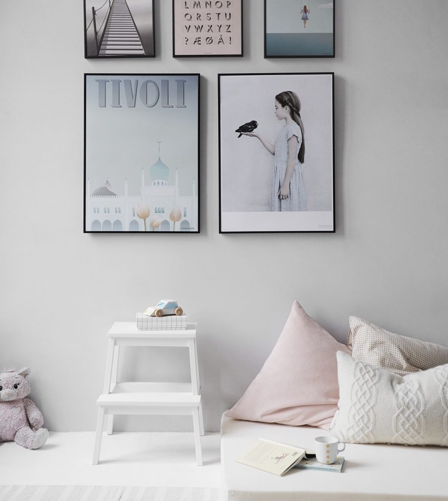 A childs bedroom decorated in pastel pink