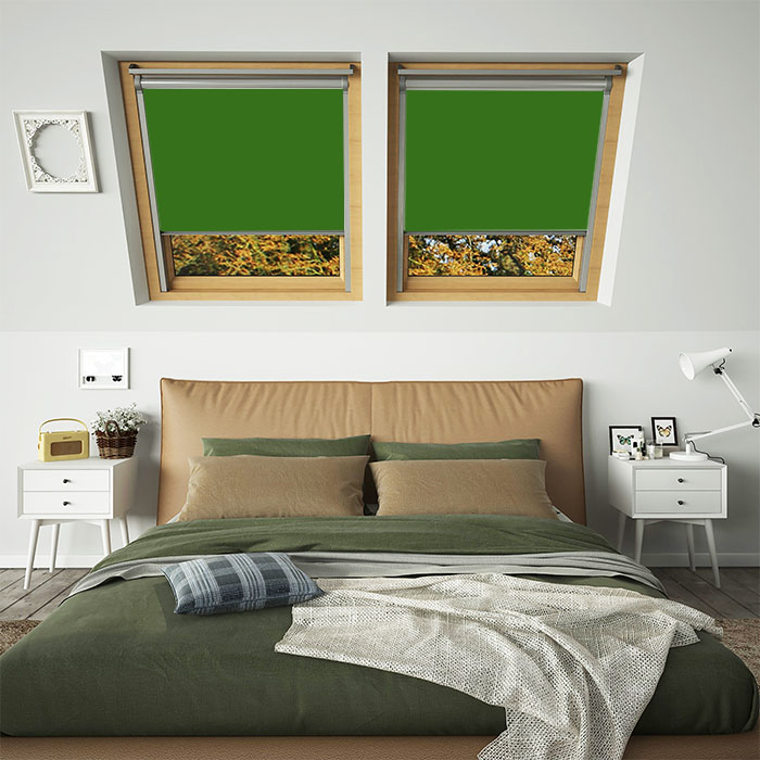 A bedroom featuring two green coloured skylight window blinds