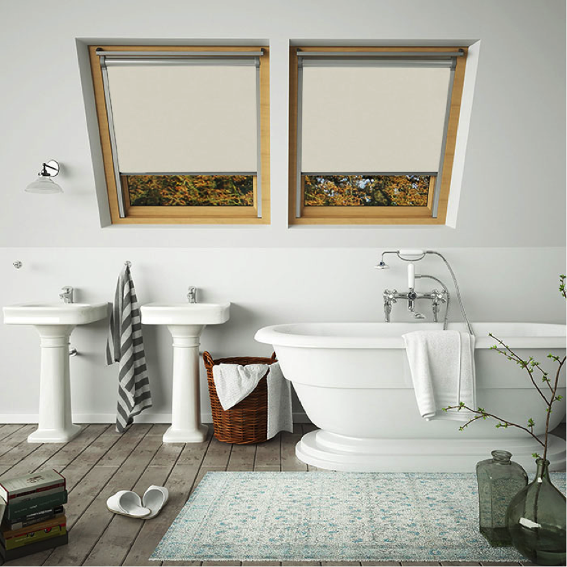 A pair of neutral skylight blinds for velux windows in a bathroom