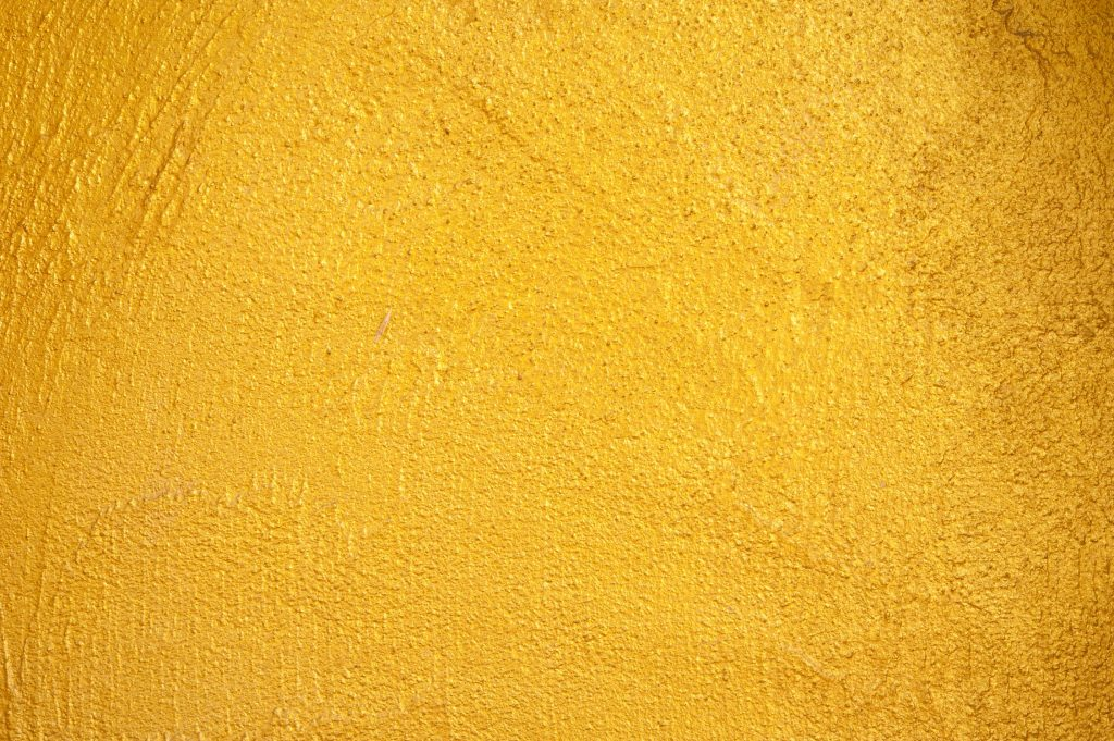 Gold paint layered onto a flat surface