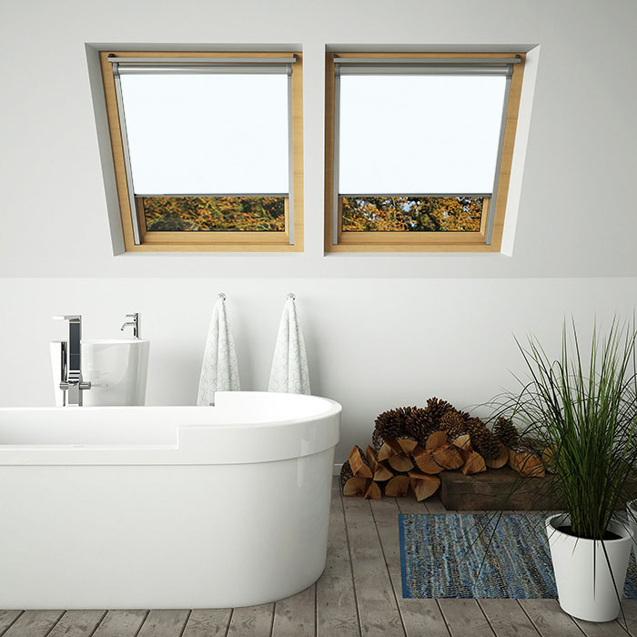 A bathroom with white skylight blinds for velux windows