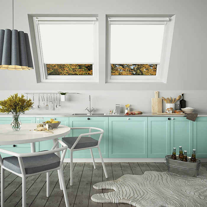White skylight blinds in a turquoise and white themed kitchen