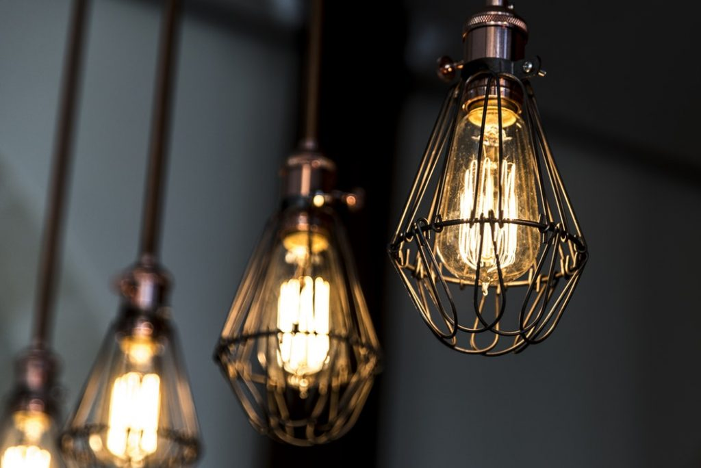 Four industrial style light shades