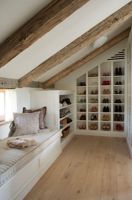 An image of built-in shoe storage within a loft conversion wardrobe