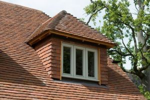 An image showing a hipped roof dormer loft conversion