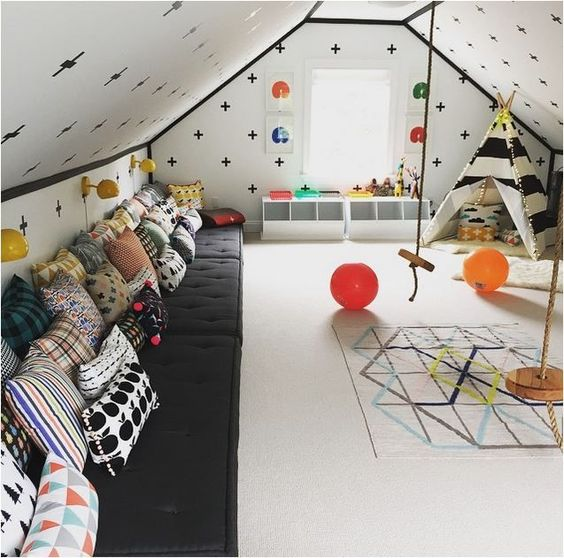 An image of a colourful and useful children's playroom in a loft converion