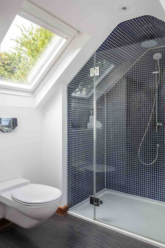 An image showing a modern and bright bathroom fitted in a loft conversion space