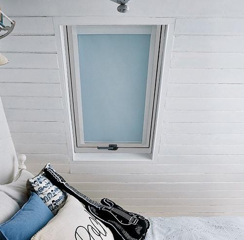 White frame skylight windows blinds