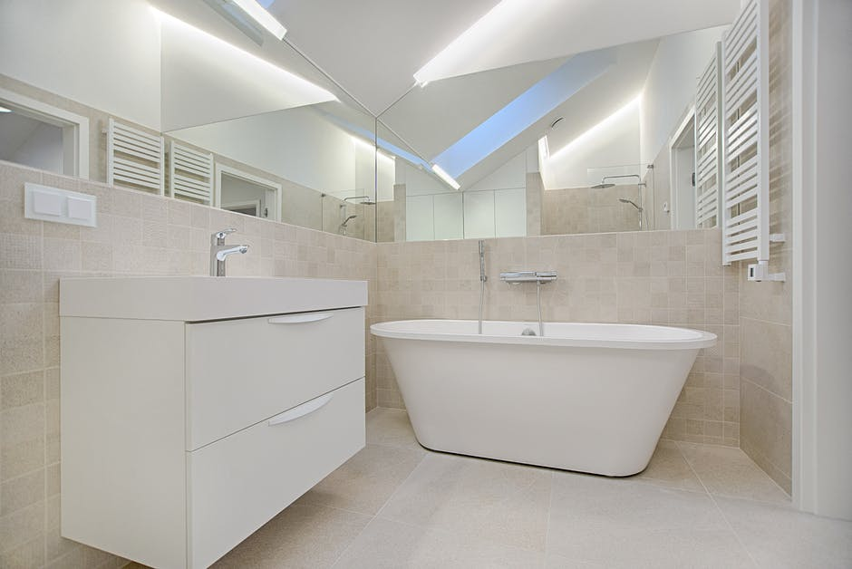 An image showing a neutral coloured bathroom with heated towel rails, suitable for loft conversion rooms