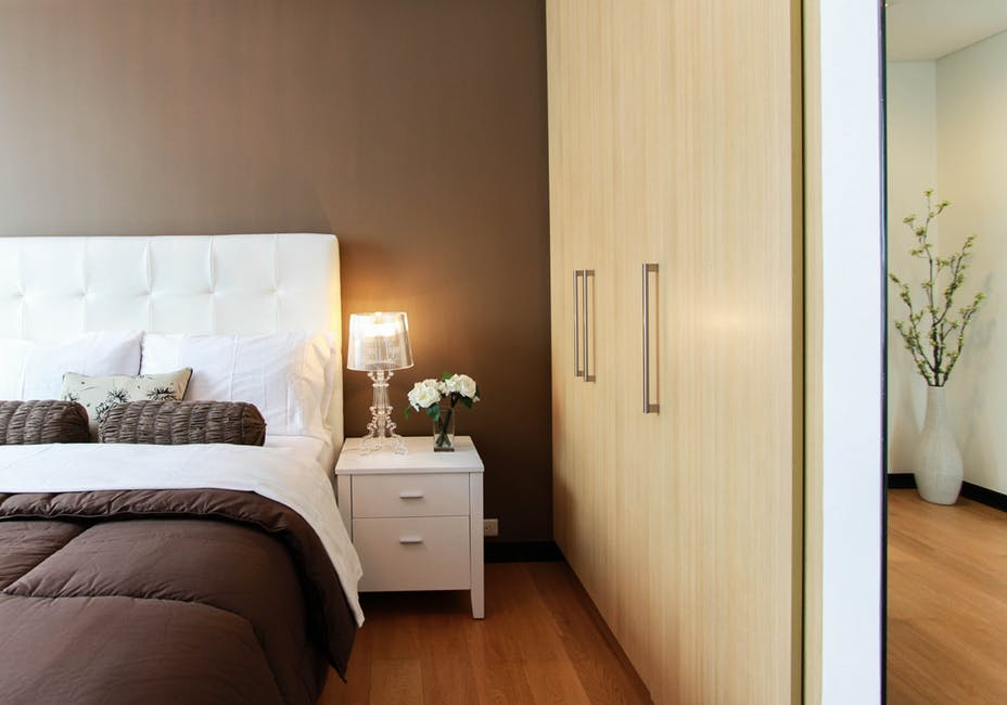 An image showing built-in wardrobes in a loft conversion bedroom