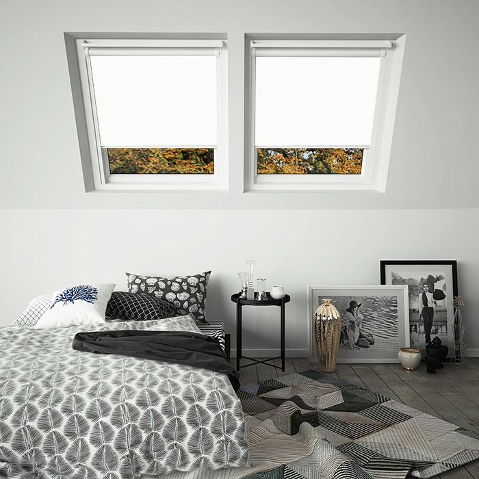 An image showing white skylight VELUX compatible blinds in white frames
