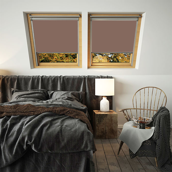 An image showing brown VELUX compatible blinds on double windows