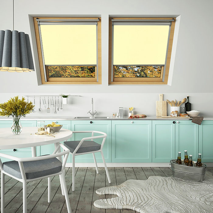 An image showing lemon coloured VELUX compatible blinds on a double window in a kitchen