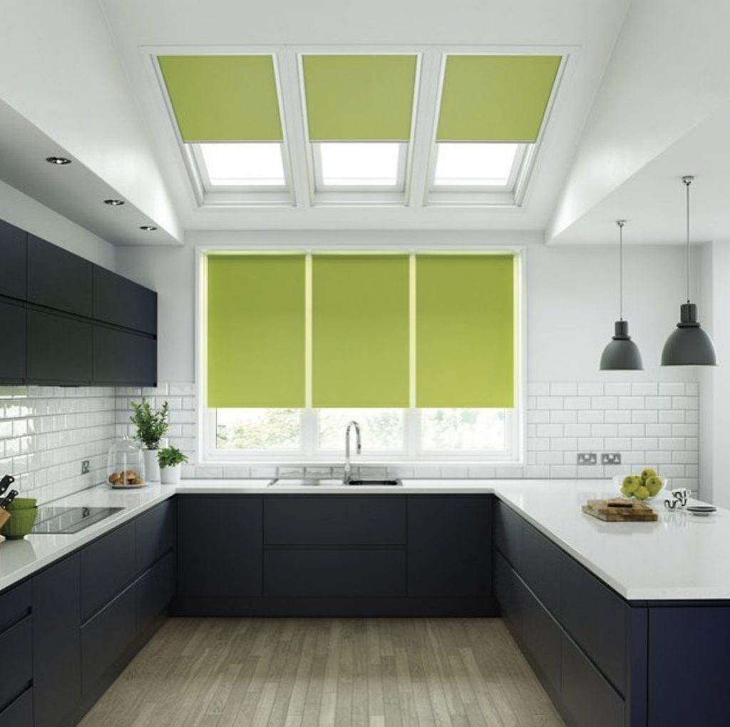 Lime green skylight blinds and roller blinds in a monochrome kitchen